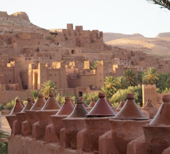 Tajine dishes in front of Ait Ben Haddou